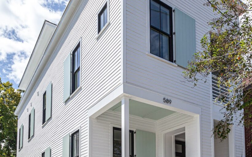 Modern Charleston row house, blue shutters, concrete entry steps, custom home builder, Charleston, modern custom home , custom home